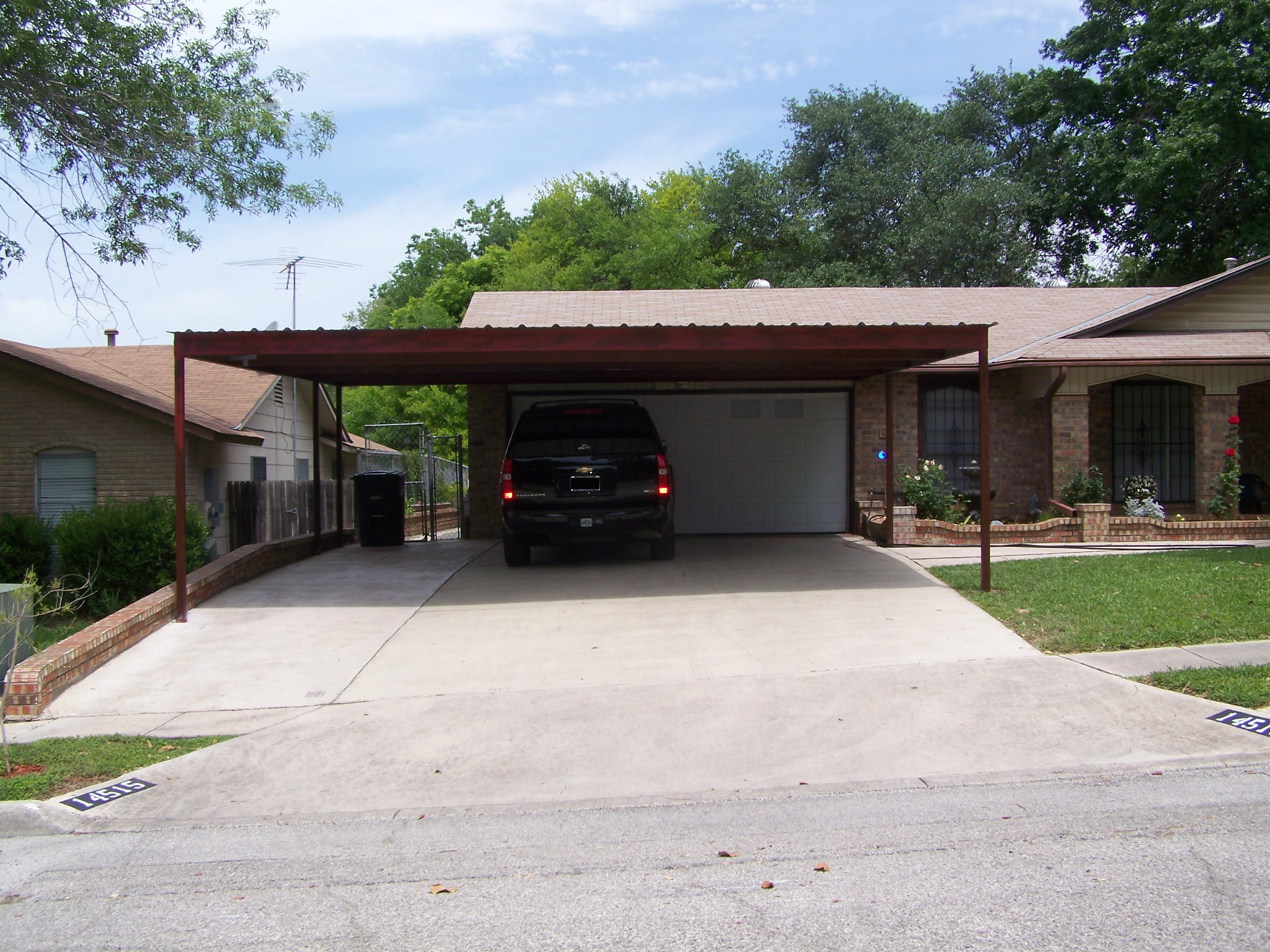 Two car attached carport north san antonio carport patio for Carport deck