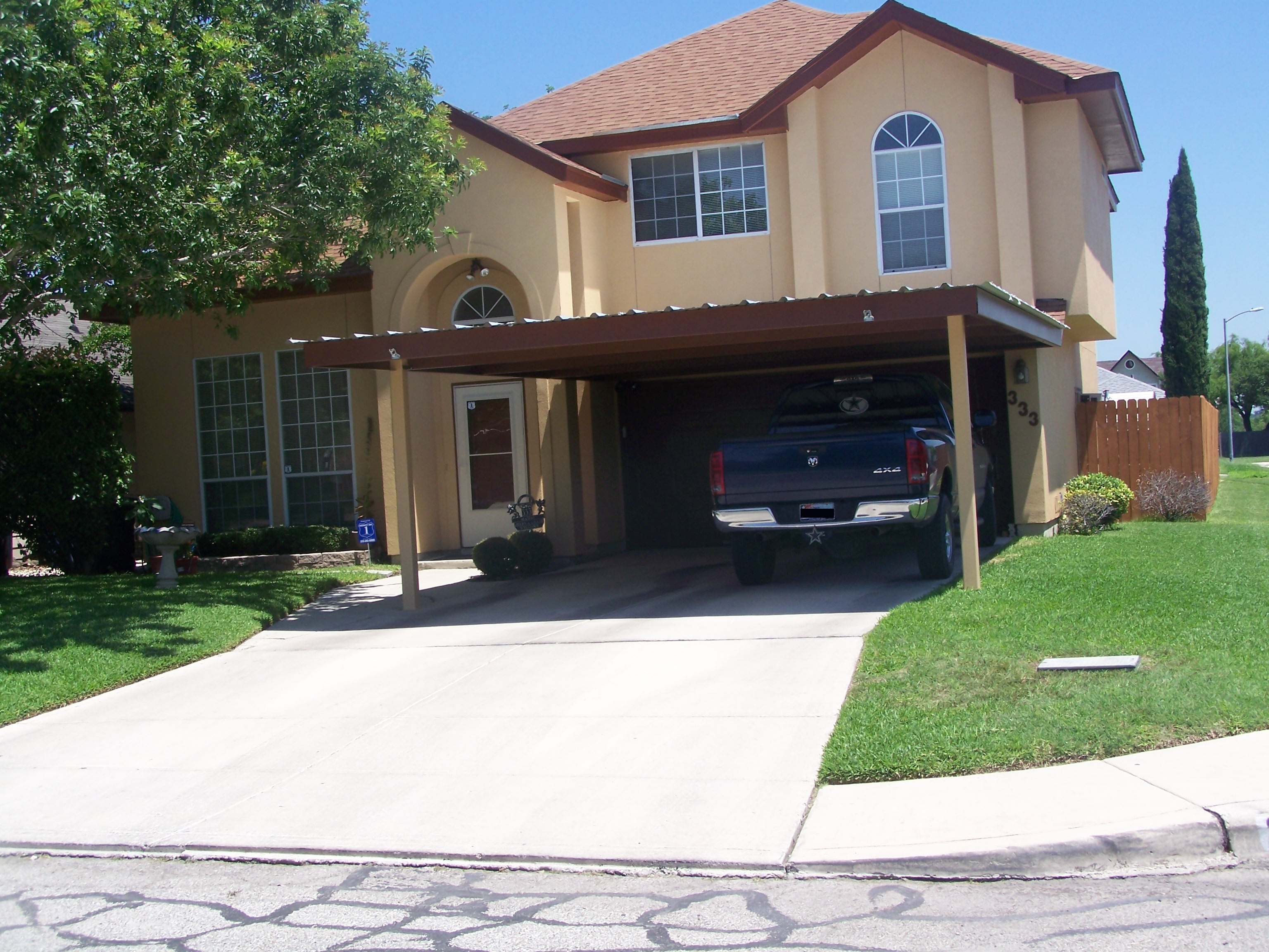 Attached two post custom two car carport south san antonio for House with carport