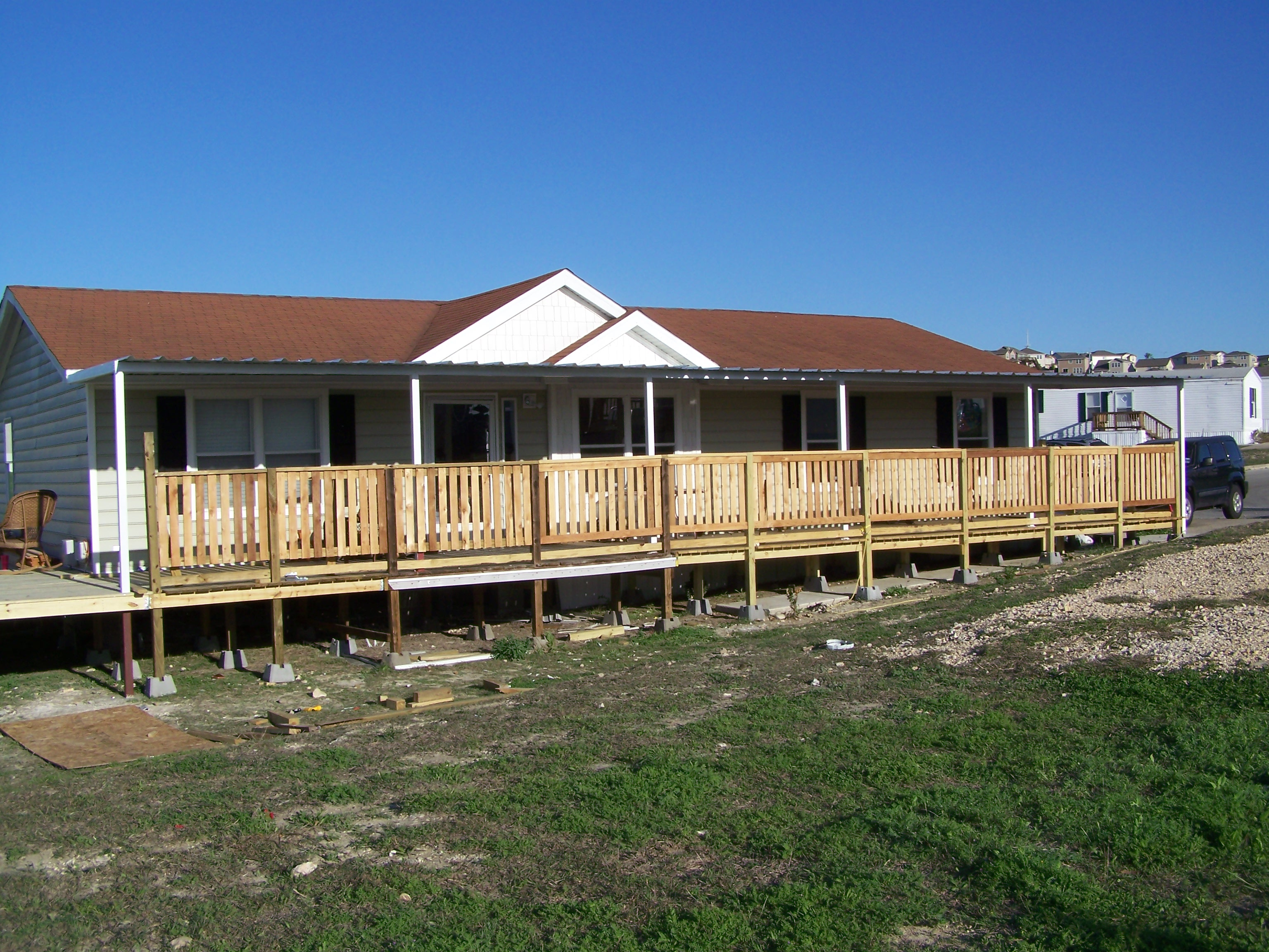 Custom attached awning mobile home north san antonio for Carport deck