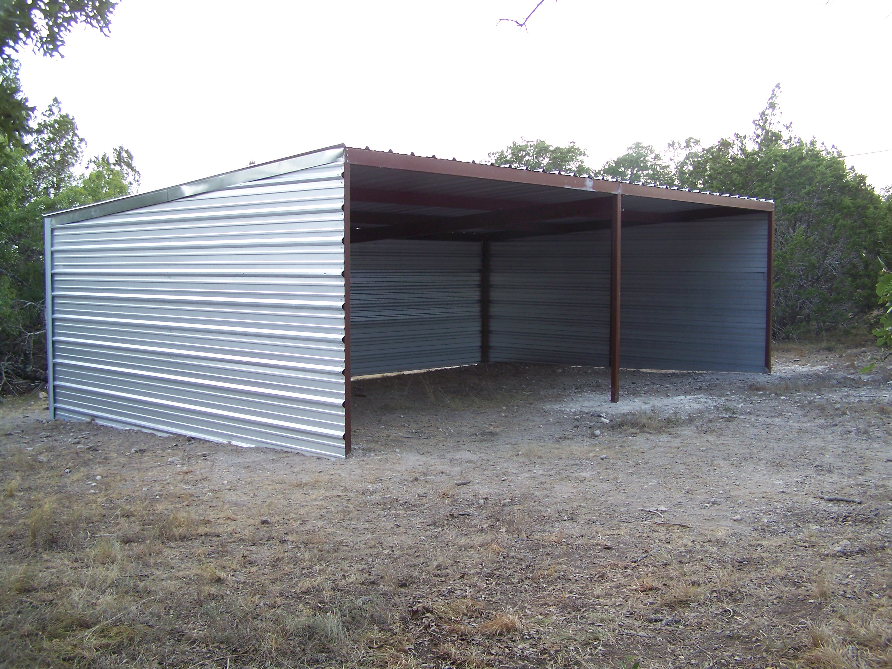 Custom all steel pole barn pipe creek texas carport for Metal barn pictures