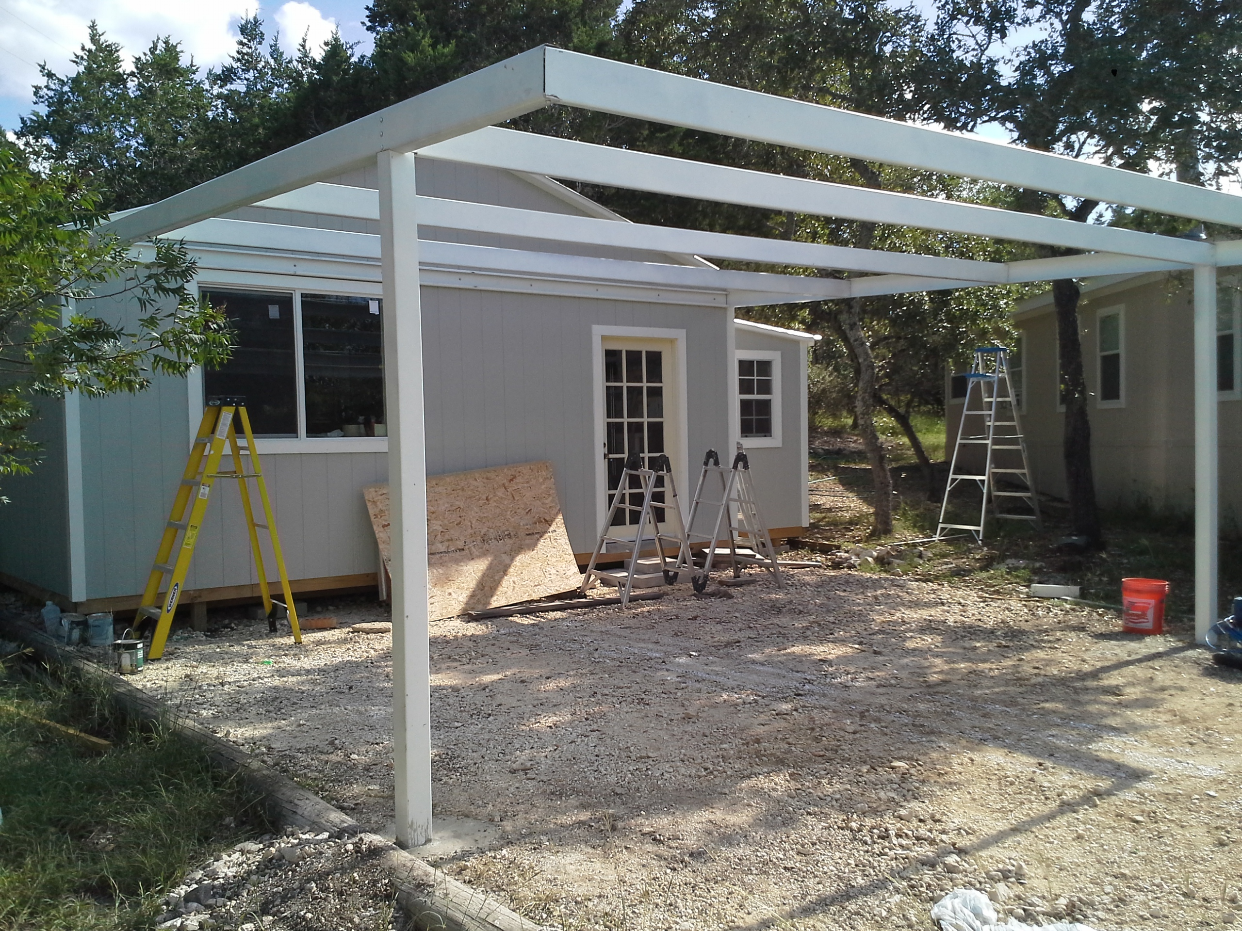 Cotulla texas attached custom all steel carport carport for Carport deck